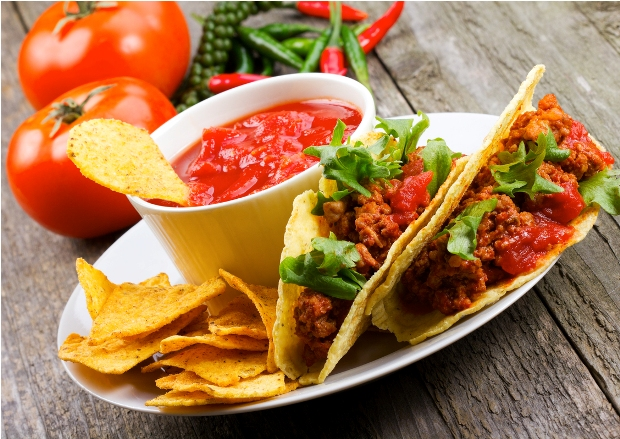 Two tacos with chips and salsa