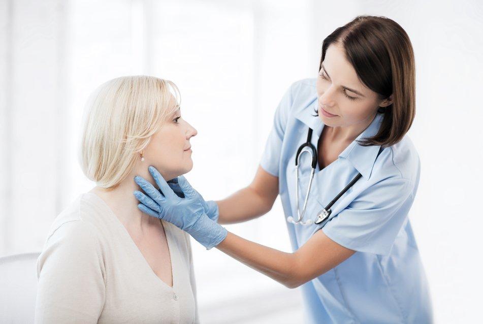 Doctor examining patient's neck